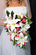 People, woman, women, female, females, marriage, marriages, wedding dress, wedding dresses, dress, dresses, wedding, weddings, bride, brides, fashion, dress, dresses, ceremony, ceremonies, flower, flowers, bouquet, bouquets, cut flowers, lilium, liliums, white, white flower, white flowers.