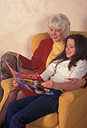 People, family, families, indoors, woman, women, female, females, grandparent, grandparents, girl, girls, chair, chairs, read, reads, reading, magazine, magazines, book, books, grandaughter, grandaughters, dog, dogs, Australia, Sport pictures, Sports, balloon images, hot air balloons