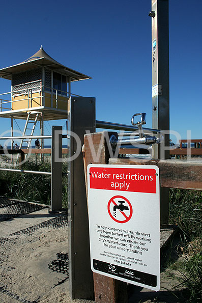 beach shower with water restriction sign main beach gold coast queensland australia. Black Bedroom Furniture Sets. Home Design Ideas