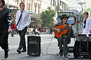 Australia, vic, victoria, melbourne, tram, trams, speaker, speakers, man, men, male, males, busker, buskers, busking, guitar, guitars, music, musical instrument, musical instruments, bouke, bourke street, bourke street mall, mall, malls.