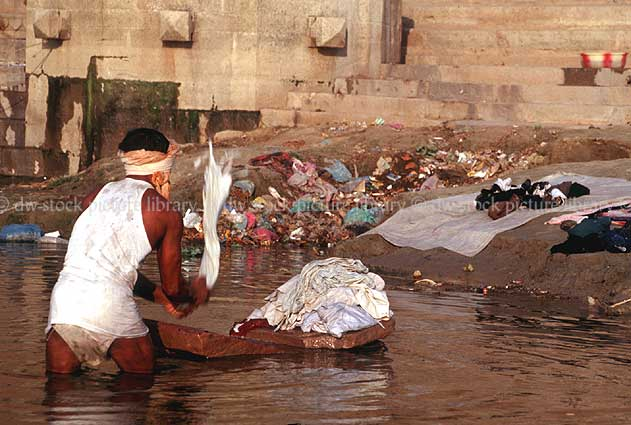 stock photo image: India, river, rivers, ganges, ganges river, washing, laundry, man, men, male, males, occupation, occupations, varanasi, dhubi.