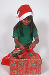 People, child, children, female, females, girl, girls, Christmas, Christmas time, present, presents, gift, gifts, christmas present, christmas presents, hat, hats, christmas hat, christmas hats, santa hat, santa hats, christmas paper, wrapping paper, package, packages, box, boxes, Australia, Sport pictures, Sports, balloon images, hot air balloons