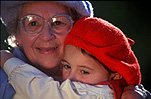 People, child, Children, girl, girls, female, females, girl, girls, granddaughter, granddaughters, grandparent, grandparents, grandmother, grandmothers, family, families, old people, elderly people, elderly person, elderly persons, old woman, old women, elderly woman, elderly women, hat, hats, beret, berets, glasses, pair of glasses, spectacles, hug, hugs, hugging, embrace, embraces, embracing, cuddle, cuddles, cuddling, smile, smiles, smiling, happy, happiness, old, elderly, aged.