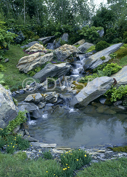 Rock waterfeature leading to garden pond for Fish pond rocks