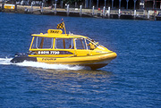 Transport, transportation, vehicle, vehicles, boat, boats, boating, taxi, taxis, taxi cab, taxi cabs, cab, cabs, water, water scene, water scenes, flag, flags, water taxi, water taxis, australia, Sydney, Sydney Harbour, Sydney Harbor, NSW, New South Wales, sign, signs.