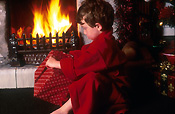 People, child, children, boy, boys, male, males, indoors, fire, fires, flame, flames, present, presents, gift, gifts, christmas, present, presents, AM04,