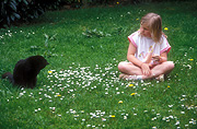 Australia, people, child, children, girl, girls, female, females, cat, cats, domestic, domestic cat, domestic cats, lawn, lawns, outdoors.