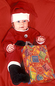 Christmas, christmas scene, christmas scenes, baby, babies, hat, hats, costume, costumes, infant, infants, infancy, child, children, people, present, presents, christmas present, christmas presents, gift, gifts, box, boxes, package, packages, Australia, Sport pictures, Sports, balloon images, hot air balloons