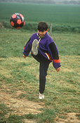 People, child, children, boy, boys, male, males, football, footballs, kick, kicks, kicking, ball, balls, outdoors, soccer, soccer ball, soccer balls, Australia, Sport pictures, Sports, balloon images, hot air balloons