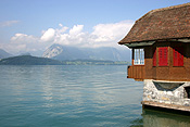 Europe, Switzerland, Swiss, Interlaken, lake, lakes, thun, lake thun, water, roof, roofs, rooves, house, houses, housing, architecture, window, windows, shutter, shutters.